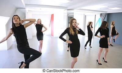 Young women are changing pose standing in model school....