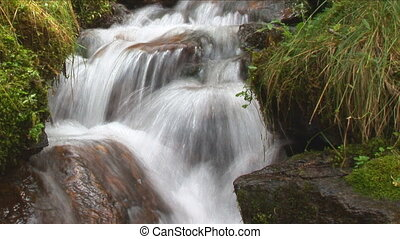 idyllic waterfall close slow shutter - closeup of idyllic...