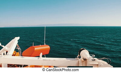 Cargo Ferry Moving on Sea. Deck of the ship sailing in the...