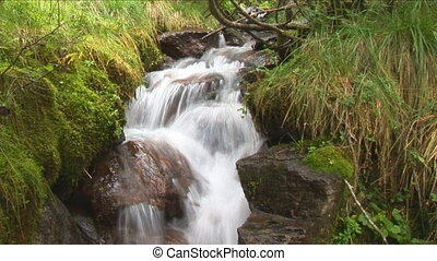 idyllic waterfall slow shutter - idyllic small waterfall in...