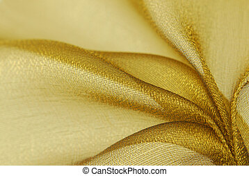 golden organza fabric - close up of golden organza fabric...