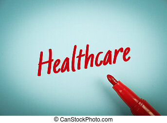Red Text Healthcare - Text Healthcare written on blue paper...