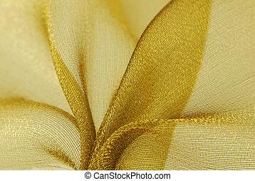 golden organza fabric - close up of golden organza fabric...
