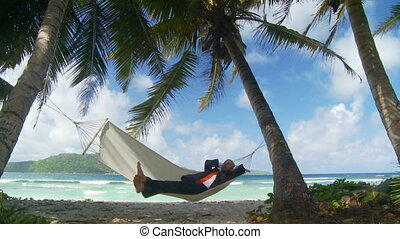 young businessman in hammock - satisfied businessman...