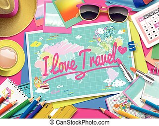 I love travel on map, top view of colorful travel essentials...