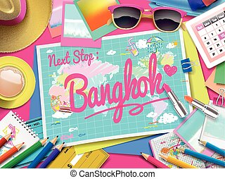 Bangkok on map, top view of colorful travel essentials on...