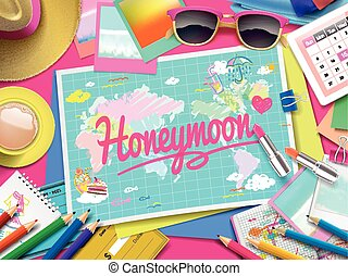 Honeymoon on map, top view of colorful travel essentials on...