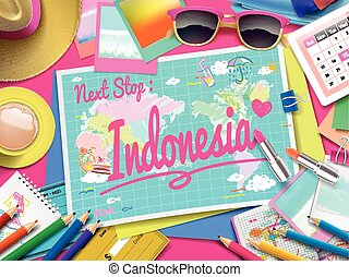 Indonesia on map, top view of colorful travel essentials on...