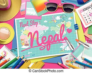 Nepal on map, top view of colorful travel essentials on...