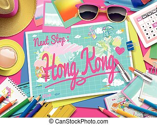 Hong Kong on map, top view of colorful travel essentials on...