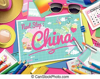 China on map, top view of colorful travel essentials on...