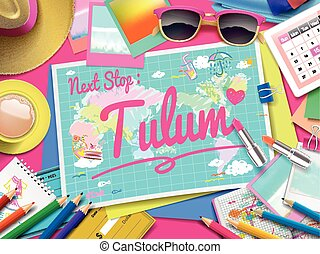 Tulum on map, top view of colorful travel essentials on...