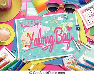 Yalong Bay on map, top view of colorful travel essentials on...