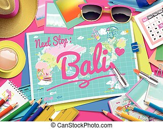 Bali on map, top view of colorful travel essentials on table