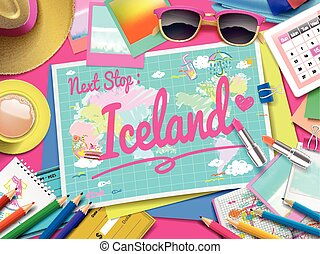 Iceland on map, top view of colorful travel essentials on...