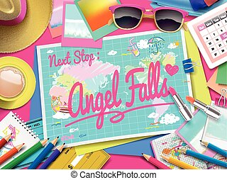 Angel Falls on map, top view of colorful travel essentials...