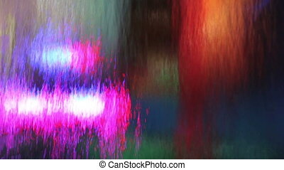 Multicolored waterfall - Fastflowing Waterfall backlit by...