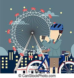 cyclist in theme park at night