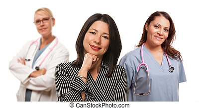 Hispanic Woman with Female Doctor and Nurse Isolated on a...