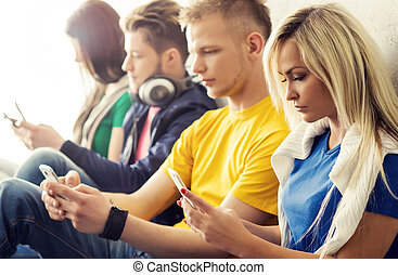 Happy students with smartphones. Social network and internet...