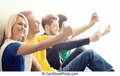 Group of hipsters taking selfie Students on a break - Group...