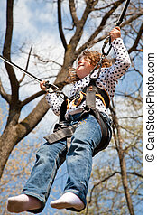 Little girl in a bungee - Little girl going up and down on a...
