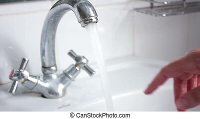 Water from opened faucet