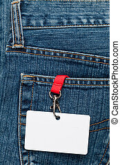 Blank badge in a pocket - Blue jeans detail with blank badge