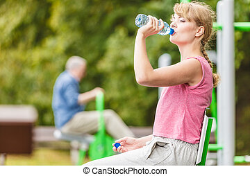 Woman with drinking water taking break Fitness - Woman with...