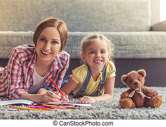 Mother and daughter - Cute little girl and her beautiful...