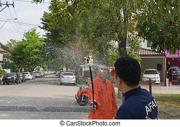 Preparedness for fire drill - Bangkok, Thailand. Many people...