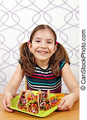 happy little girl with tacos