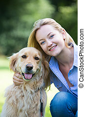 Woman Hugging Pet Golden Retriever