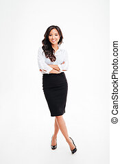 Portrait of a smiling asian businesswoman standing with legs...