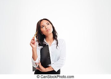 Beautiful pensive asian businesswoman holding clipboard and...