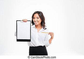 Smiling young asian businesswoman pointing pencil at blank...