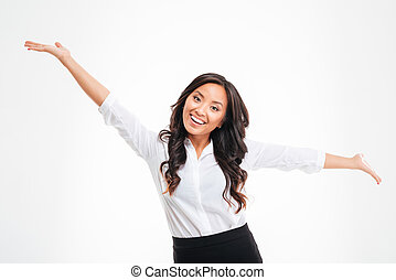 Portrait of a happy asian busineswoman with raised hands up...