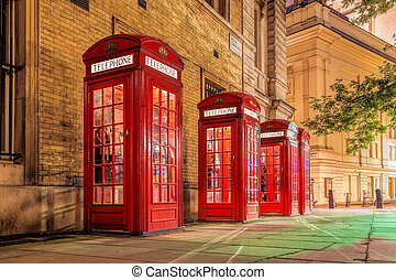 Famous red telephone booths in Covent Garden street, London, England