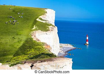 Beachy Head Lighthouse with chalk cliffs near the...