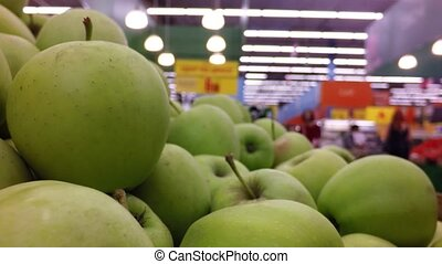 green apples on the shelf of the market