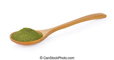 dry green tea in wood spoon