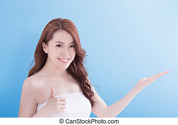 Beauty woman with charming smile and show some to you with...