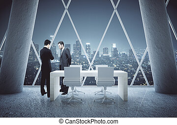 Thoughtful businessmen in conference room - Two thoughtful...