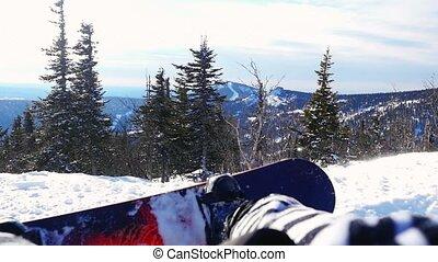 Snowboarder man in suit of kigurumi of zebra relaxing in the...