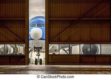 Airplane in front of half opened door to hangar - Blue...