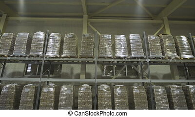 Large furniture warehouse. Mezzanine shelving with large...