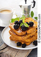 Pumpkin french toast with berries and maple syrup for...