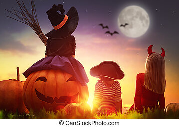 children and pumpkins on Halloween - Happy brother and two...