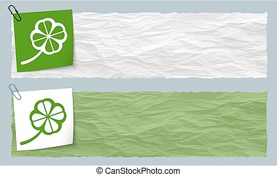 Two banners of crumpled paper with cloverleaf
