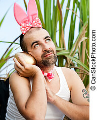 Easter Rabbit On The Road - Man Wearing Rabbit Hat With Big...